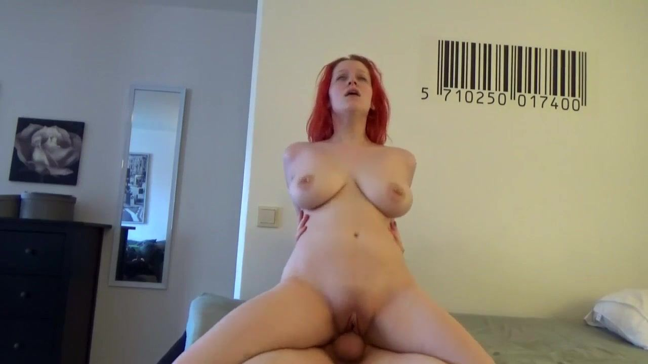 Busty redhead babe rides big cock as cowgirl in homemade porn