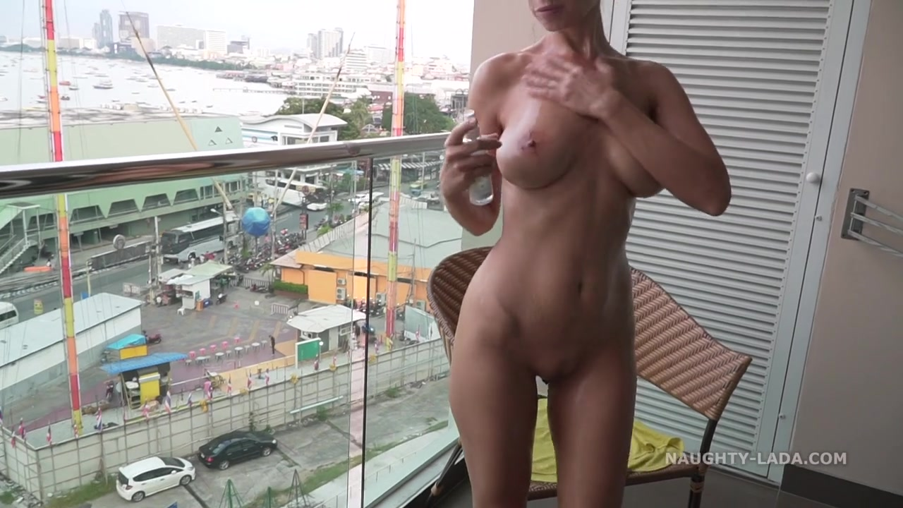 Dirty mom flasher - oiled up body on the balcony - Russian Milf